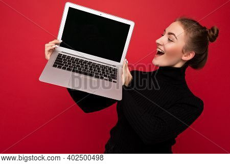 Beautiful Surprised Amazed Young Brunette Woman Holding Computer Laptop Wearing Black Longsleeve Loo