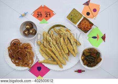 Special Gujarati Cuisine For Uttarayan Festival. Variety Of Dishes Like Fafda, Jalebi, Undhiyu, Raw