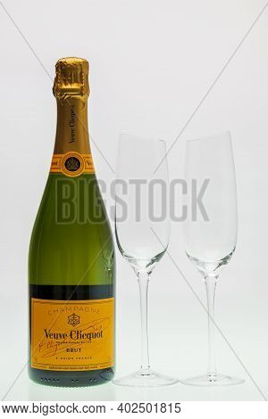 Close Up View Of Bottle Of Authentic French Brut Champagne Veuve Clicquot And Two Slim, Tall And Ele
