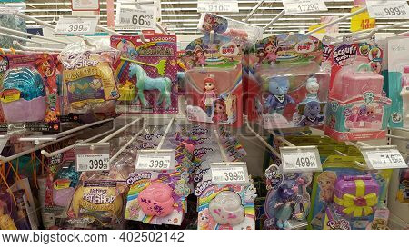 Packages With Dolls For Sale In A Supermarket