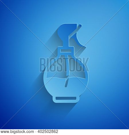 Paper Cut Water Spray Bottle Icon Isolated On Blue Background. Sprinkler For Ironing. Paper Art Styl