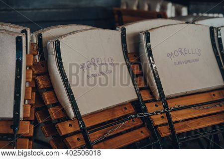 London, Uk - November 19, 2020: Folded Chairs Outside Closed Morellis Gelato And Espresso Bar Inside