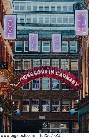London, Uk - November 19, 2020:  Choose Love In Carnaby Christmas Lights In Carnaby Street, Pedestri