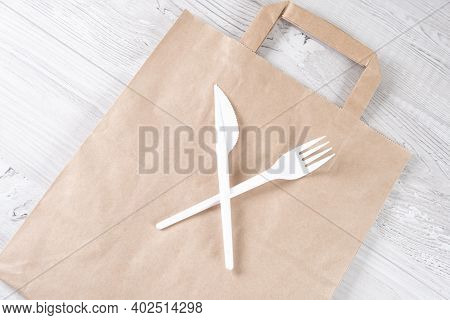 Stop Using Plastic. Plastic Waste Concept. Close Up. Brown Ecological Paper Bag And Crossed Plastic