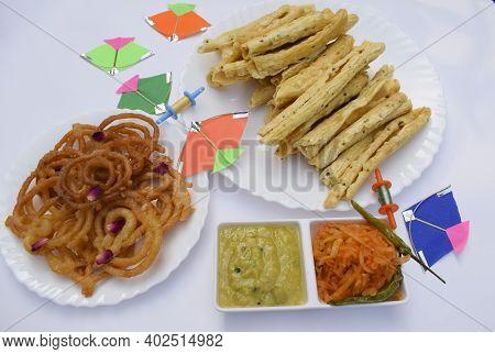 Gujarati Famous Authentic Cuisine Of Fafda, Jalebi, Kadhi Ki Chutney, Grated Raw Papaya And Green Ch
