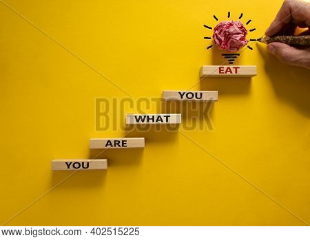You Are What You Eat Symbol. Stack Of Wooden Blocks. Words 'you Are What You Eat'. Male Hand With Pe