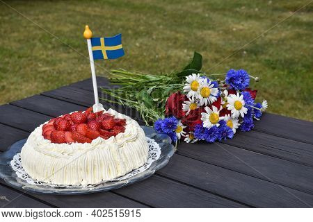Swedish Decorated Summer Table With Flowers, Cream Cake And Flag Miniature