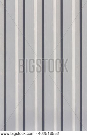 Texture Of The Wall With Gray Vertical Siding Panels In Strips