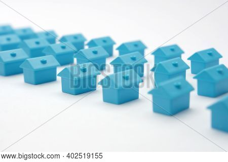 Real Estate In Cottage Village. Home Owner Association. Rows Toy Houses. Miniature Blue Houses Arran