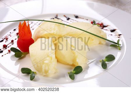Mashed potatoes or pureed potatoes usually given as side dish to main meal.