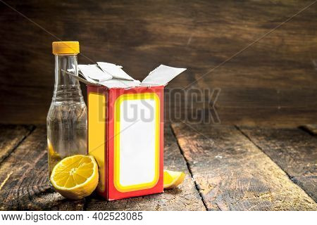 Baking Soda With Vinegar And Lemon. On Wooden Background.