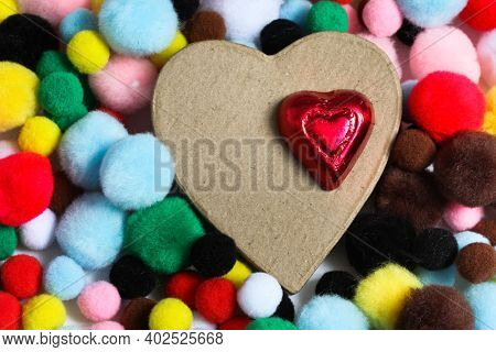 Heart`s with colored pompoms background