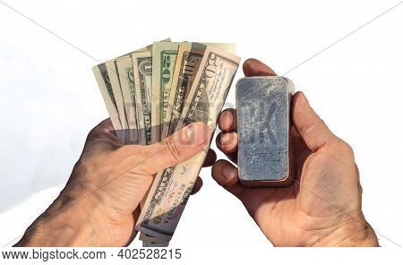 Bullion Bar Of Pgm And Dollar Bills In The Hands Isolated On White.
