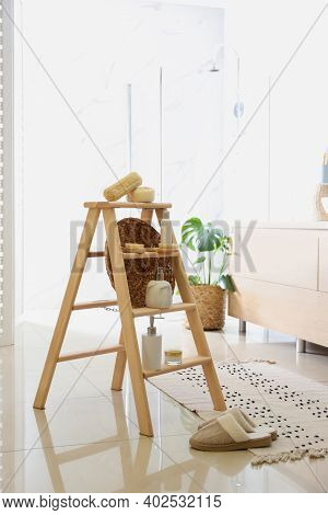 Dispensers And Different Toiletries On Decorative Ladder In Bathroom. Idea For Interior Design
