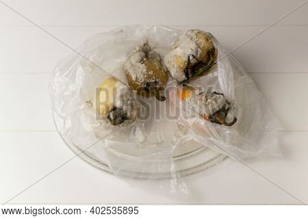 Rotten Peppers With Mold In A Plastic Bag. Spoiled Food. Food Waste Concept. Copy Space.