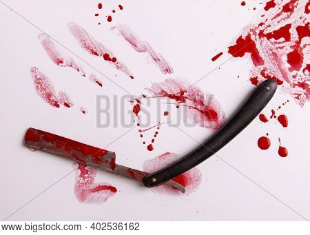 Blood Trail And An Old Straight Razor. Blood Drops. Murder And Suicide Concept. Razor Sharp And Bloo