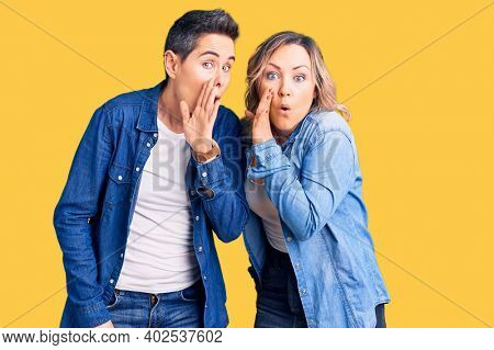 Couple of women wearing casual clothes hand on mouth telling secret rumor, whispering malicious talk conversation
