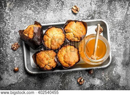 Fruit Honey Muffins. On A Rustic Background.