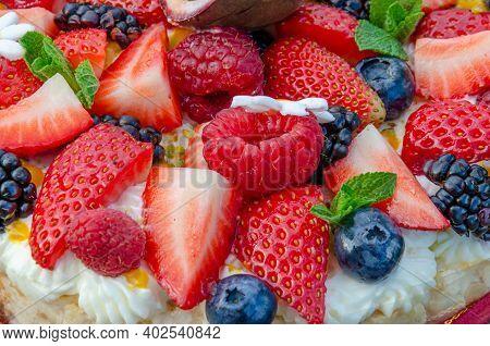 Anna Pavlova French Dessert With Blackberries,blueberries, Passion Fruit, Raspberries, Strawberries.