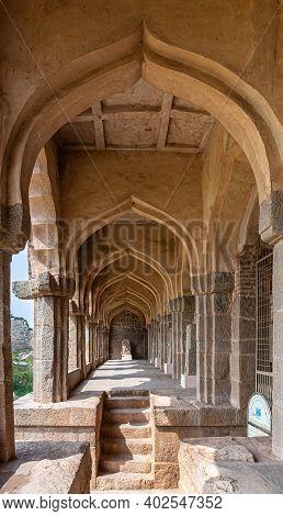 Hampi, Karnataka, India - November 5, 2013: Zanana Enclosure. Long Tunnel Of Arches At Archeological