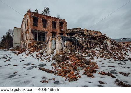 Remains Of Demolished Old Industrial Building. Pile Of Stones, Bricks And Debris