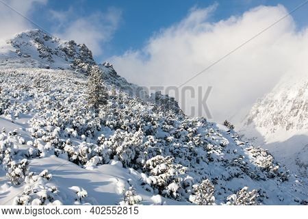 snow covered mountain slope in Hight Tatras, winter in Slovakia