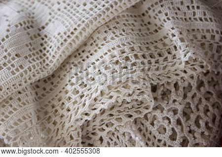 Old, Vintage Crocheted White Bedspread Or Shawl At A Flea Market