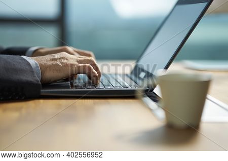 Close-up Shot Of Hands Of An Asian Businessman Working On Laptop Computer