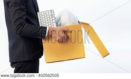 Man Holding The Office Equipment Box And His Belongings On White Background. Termination Of Employme