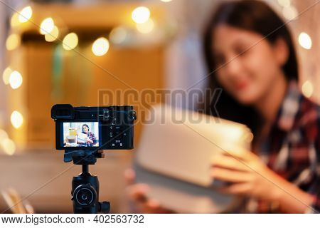 Vlogger Asian Woman Happiness While Make Money Vlogging Online With A Camera On Tripod. Live Streami