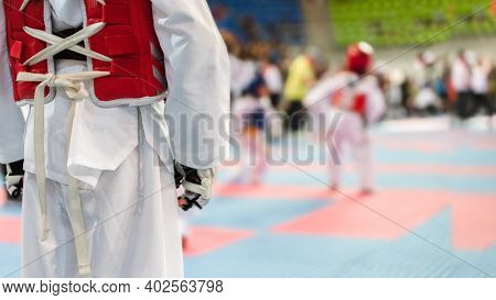 Moment Of Taekwondo Kids In The Stadiums. Athlete To Strike An Opponent During The Tournament Taekwo