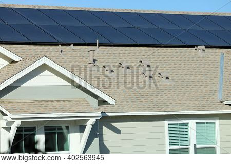 Solar Panels On A Rooftop Creating Alternative Energy Taken On A Residential Building