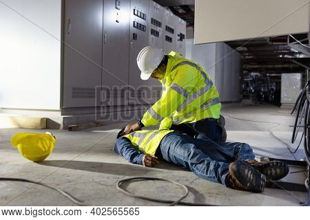 Check Response And Pulse, Life-saving And Rescue Methods. Accident At Work Of Electrician Job Or Mai