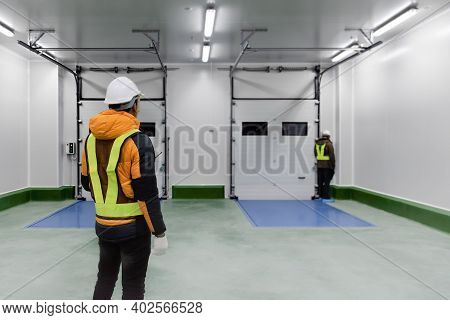 Staff Worker Standing Control Inside Loading Room For Goods In Cold Warehouse Storage, Loading For D