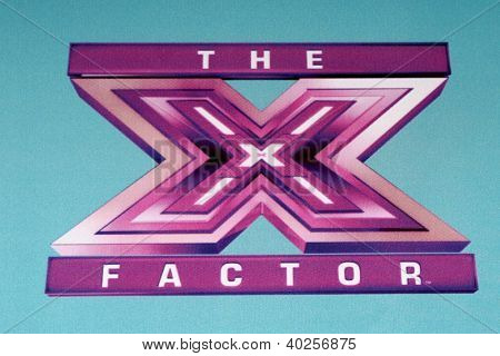 LOS ANGELES - DEC 17:  X Factor Symbol at the 'X Factor' Season Finale Press Conference at CBS Television City on December 17, 2012 in Los Angeles, CA