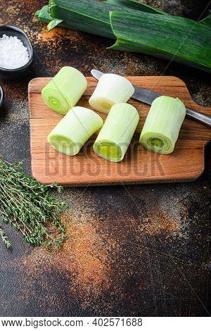 Chopped Fresh Leek For Cooking Braised Leeks On Wooden Board With Herbs Ingredients , On Rustic Meta