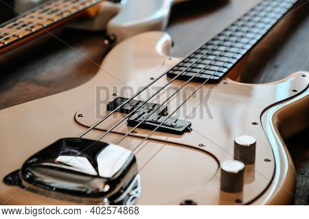 Image Of White Electric Bass Guitar Closeup