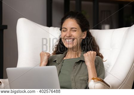 Excited Woman Triumph Winning Lottery On Laptop