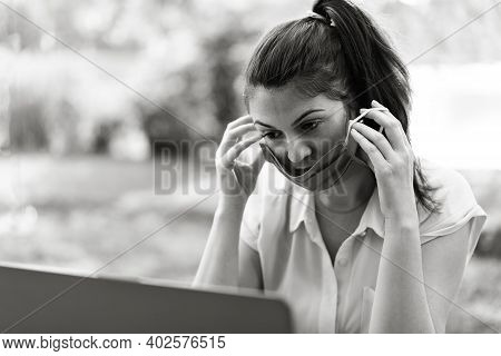 Young Woman Working Outdoors With Laptop And Wearing Red Face Mask During Coronavirus Time - Woman U