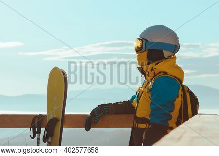 Woman In Ski Equipment Enjoying View Of Mountains