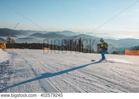Woman Sliding Down By Slope On Skies