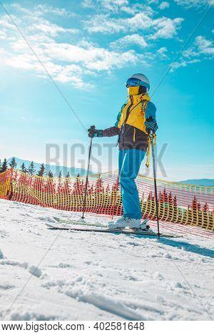 Sunny Day At Ski Slope Woman Skiing