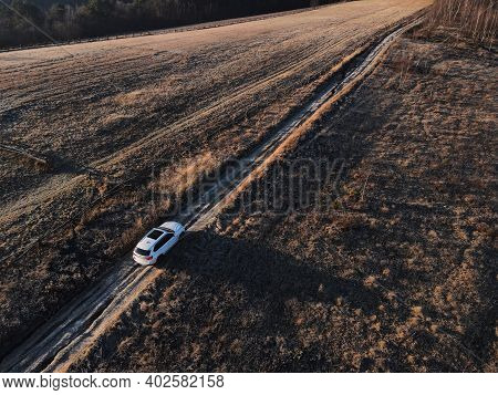 Overhead Top View Of The Suv Car Going By Trail Road