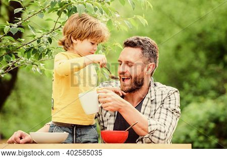Father And Son Eating Outdoor. We Like Spending Time Together. Vegetarian Diet. Healthy Food And Die