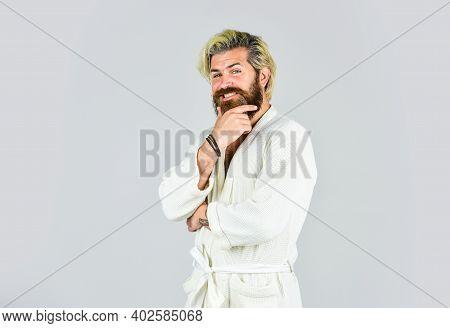 Bearded Guy Wearing White Bathrobe. Mature Man Wear Bathrobe Relaxing At Spa. Take Steps To Improve