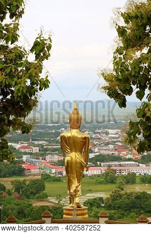 The 9 Metres High Golden Buddha Image In Walking Posture Of Wat Phra That Khao Noi, A Hilltop Temple