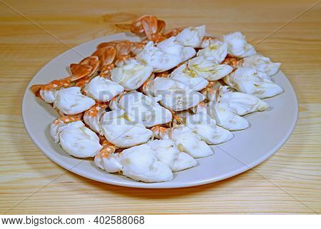 Plate Of Delectable Steamed Flower Crab Legs Served On Wooden Table