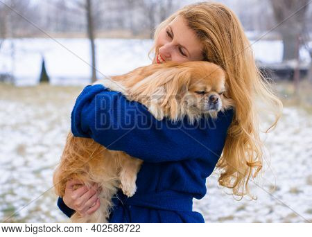 Nice Young Woman On A Walk With Her Dog Resting At Park. Best Friendship Girl And Senior Dog. Psycho