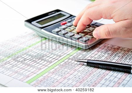 Tax Forms, Spread Sheet With Pen And Calculator.