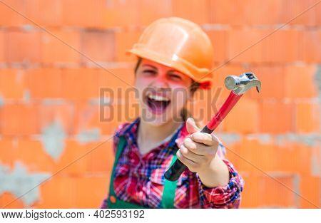 Little Girl In Hard Hat Holds Hammer. Best Repairer Ever. Learning To Use Hammer. Hammering. She Is